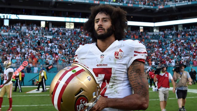 Nov 27, 2016; Miami Gardens, FL, USA; San Francisco 49ers quarterback Colin Kaepernick (7) after a game against Miami Dolphins at Hard Rock Stadium. The Dolphins won 31-24. Mandatory Credit: Steve Mitchell-USA TODAY Sports