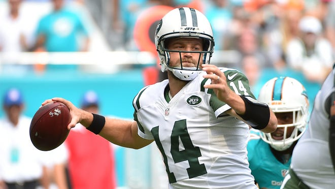 Nov 6, 2016; Miami Gardens, FL, USA; New York Jets quarterback Ryan Fitzpatrick (14) attempts a pass against the Miami Dolphins during the first half at Hard Rock Stadium. Mandatory Credit: Jasen Vinlove-USA TODAY Sports