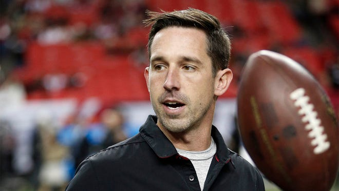 FILE - In this Dec. 18, 2016, file photo, Atlanta Falcons offensive coordinator Kyle Shanahan walks on the turf before an NFL football game against the San Francisco 49ers in Atlanta. Shanahan, expected to be one of the top targets for teams looking to replace head coaches, could be available for interviews this week. Falcons coach Dan Quinn said Monday, Jan. 2, 2017, ìI'm sure he will be contacted by some teams.î (AP Photo/John Bazemore, File) ORG XMIT: NY153