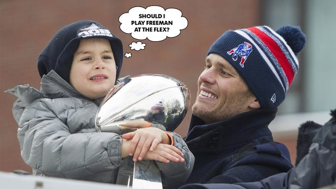 BOSTON, MA - FEBRUARY 4:  Benjamin Brady (L) holds the Lombardi trophy next to his dad, Patriots quarterback Tom Brady, on a duck boat during the New England Patriots victory parade on February 4, 2015 in Boston, Massachusetts. (Photo by Scott Eisen/Getty Images) ORG XMIT: 535843065 ORIG FILE ID: 462751452