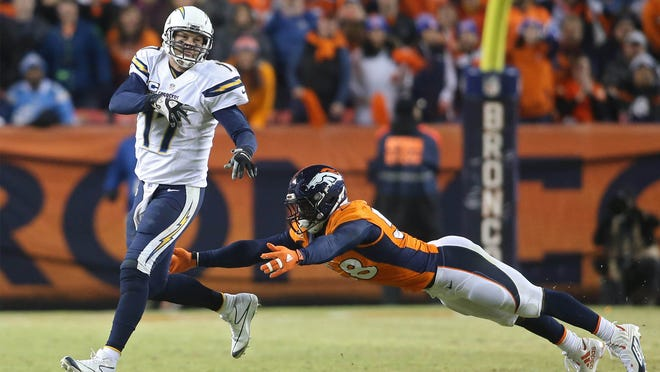 Jan 3, 2016; Denver, CO, USA; San Diego Chargers quarterback Philip Rivers (17) throws a pass under pressure from Denver Broncos outside linebacker Von Miller (58) during the second half at Sports Authority Field at Mile High. The Broncos won 27-20. Mandatory Credit: Chris Humphreys-USA TODAY Sports