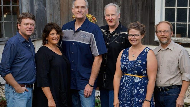 Chris Irwin, Jeanne Kuhns, Patrick Palmer, Eric Lewis, Katie Dahl and Rich Higdeon, from left, will again bring their Buckets of Rain: Bob Dylan Review to the Woodwalk Concert Series this summer.