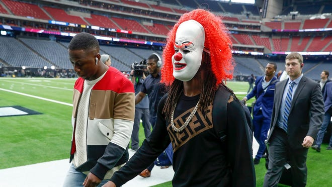 Jan 5, 2019; Houston, TX, USA; Indianapolis Colts wide receiver T.Y. Hilton (13) wears a clown mask as he and his teammates arrive for a AFC Wild Card playoff football game against the Houston Texans at NRG Stadium. Mandatory Credit: Matt Kryger/Indy Star via USA TODAY Sports