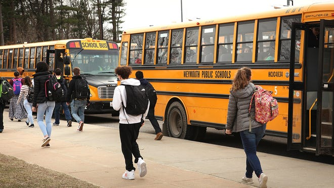 Students exit Weymouth High School at dismissal time in 2018.  Gary Higgins/The Patriot Ledger