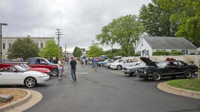 Classic cars fill the parking spaces in downtown Tecumseh for a car show on Thursday.