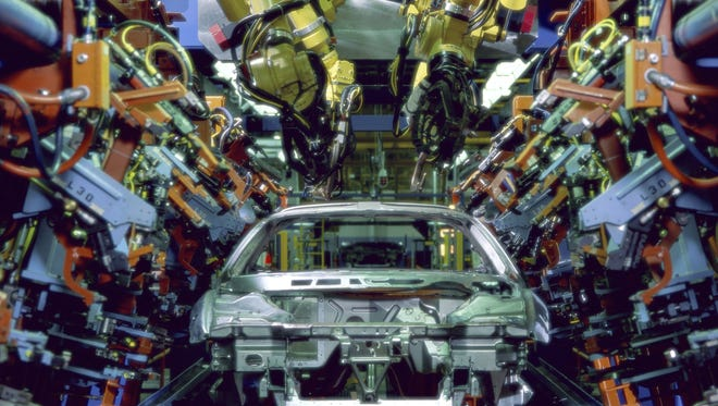 Increased use of robotics is enabling companies to make more things with relatively few workers. That, in turn, has helped spark an increase in U.S. factory jobs.