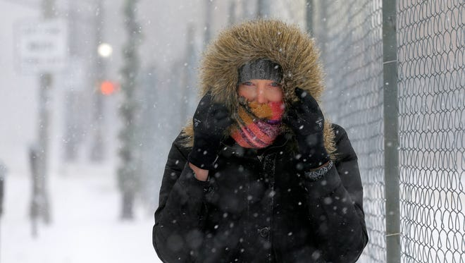 Morgan Foster of Somerville walks in the wind and snow along W. Main Street in Somerville, NJ Thursday, January 4, 2018.