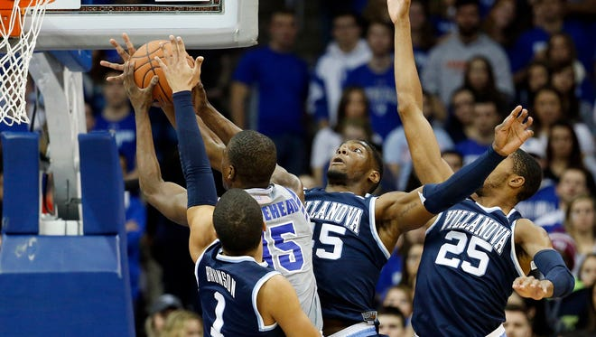 Seton Hall guard Isaiah Whitehead (15) goes up for a shot against Villanova guard Jalen Brunson (1), forward Darryl Reynolds (45) and guard Mikal Bridges (25) during the first half of an NCAA college basketball game, Wednesday, Jan. 20, 2016, in Newark, N.J. (AP Photo/Julio Cortez)