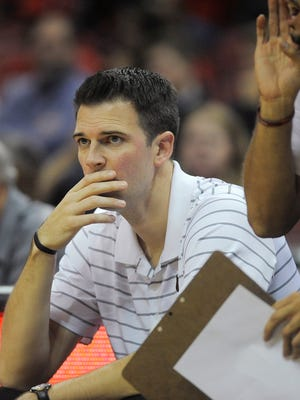 Louisville acting head coach David Padgett watches his team on Friday during the second Red-White scrimmage at the KFC Yum! Center. Oct. 27, 2017