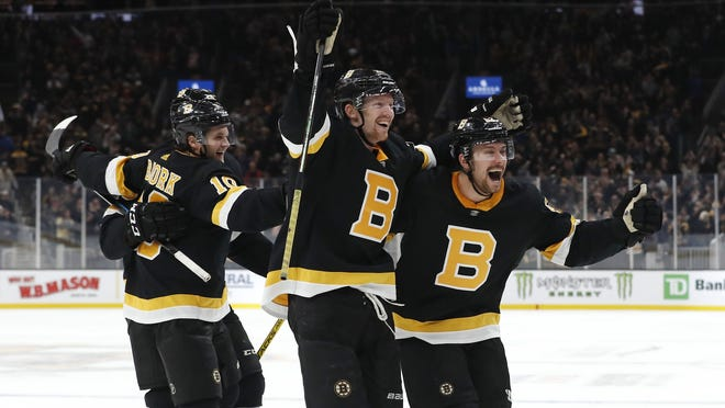Bruins center Sean Kuraly, right, and center Joakim Nordstrom, center, hope to celebrate goals during these playoffs.