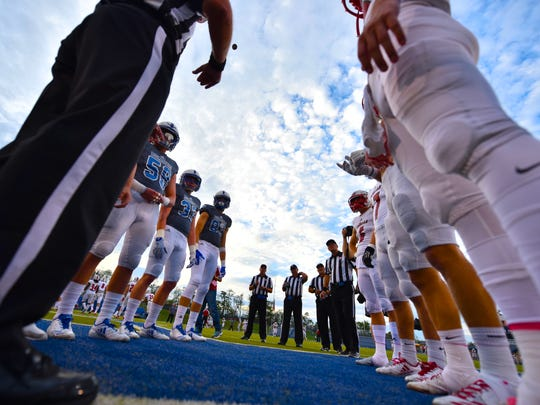 Coin toss between LaSalle and St. Xavier Friday, October 6th at St. Xavier High School