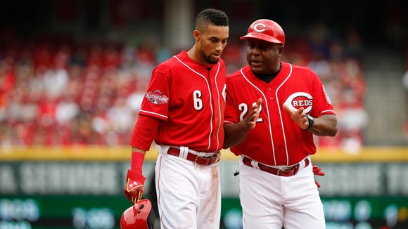 First base coach Billy Hatcher talks to Billy Hamilton, after the third inning at Great American Ball Park Thursday, April 9.