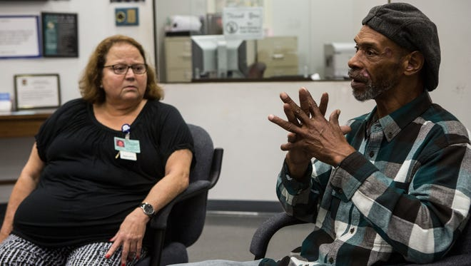 """November 3, 2016 - Anna Whalley. administrator of the Shelby County Crime Victims Center, listens as Carl Ewing recounts the time he was shot after trying to defend a female co-worker  who was being hit by a man outside. Ewing spoke at the first Gunshot Survivors Group meeting at the crime victims center. """"I still don't feel the same,"""" Ewing said about living after being shot."""