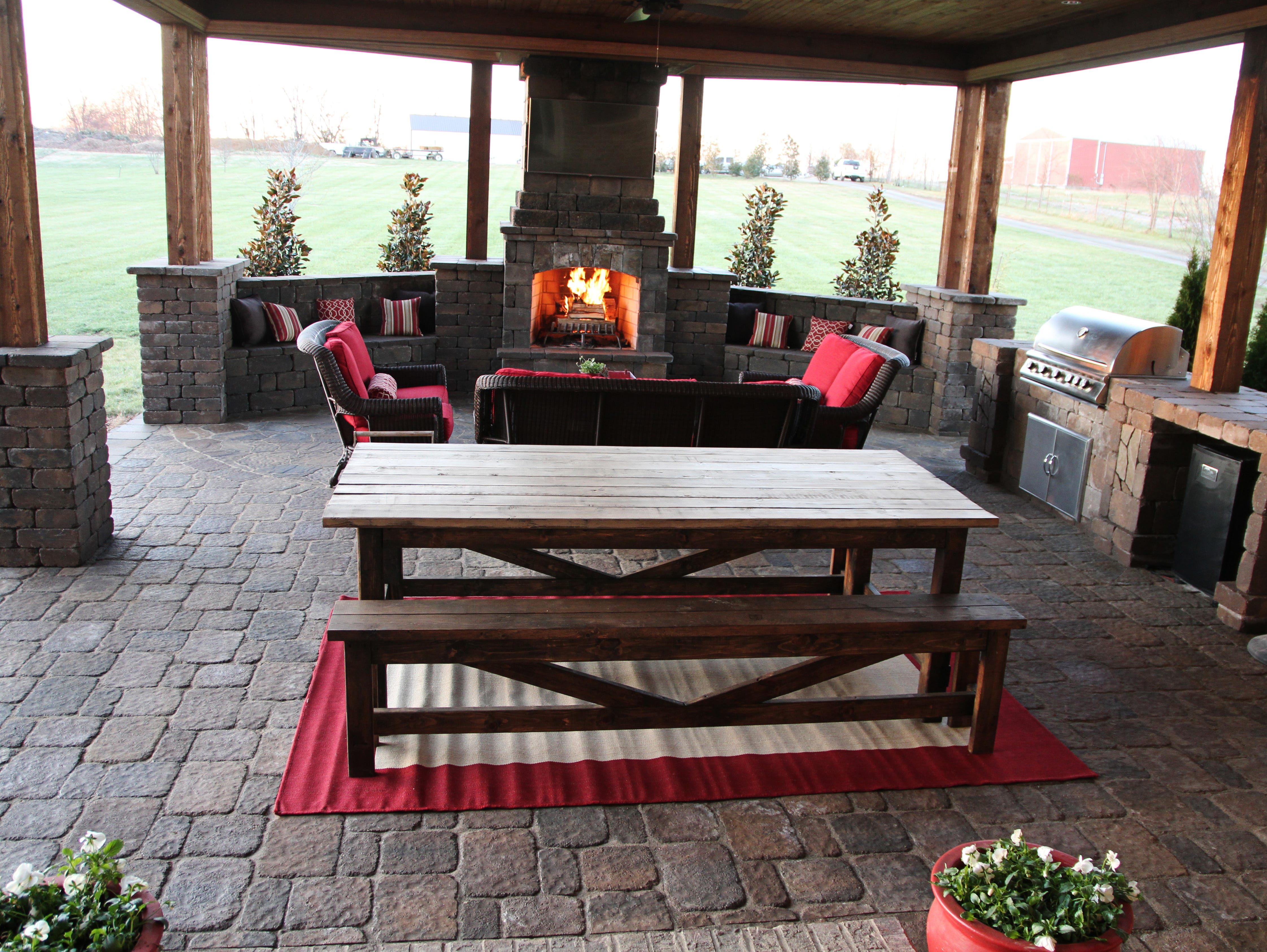 covered outdoor living spaces wooden jared crains covered outdoor living area has fireplace outdoor spaces one of biggest trends for 2018