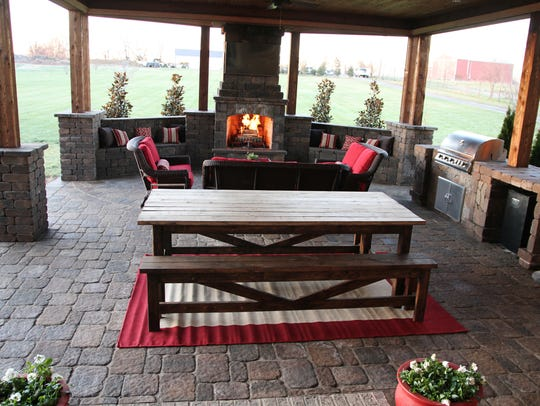 Jared Crain's covered outdoor living area has a fireplace