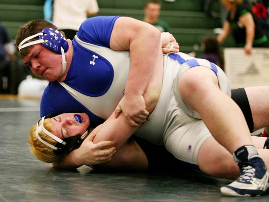 Kyler Pulliam of R.E. Lee picks up back points against David Shields of King William in the 285-pound final at the Region 2A East Tournament on Saturday, Feb. 13, 2016 at Wilson Memorial High School in Fishersville. Pulliam pinned Shields for the win.