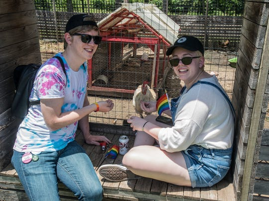 Trevor Jayroe, left, and Autumn Anderson feed chickens at EAT South. Montgomery Pride capped off a week of activities Sunday, June 24, 2018, with the Montgomery Pride Festival at EAT South downtown farm.