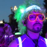 Ricky Parra is aglow in color as he waited for the Groove and Glow 5k fun run to start Saturday.