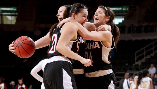 SIOUX FALLS, SD - MARCH 6:  Abi Lujan #21 and Bobbi Beckwith #24 from University of Omaha celebrate their 62-51 win over IUPUI Sunday at the 2016 Summit League Tournament. (Photo by Dave Eggen/Inertia)