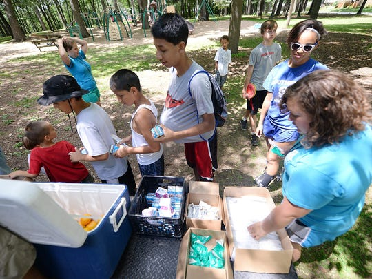 Hungry kids form a line as soon as the lunch truck arrives at the John Muir Park summer lunch site.