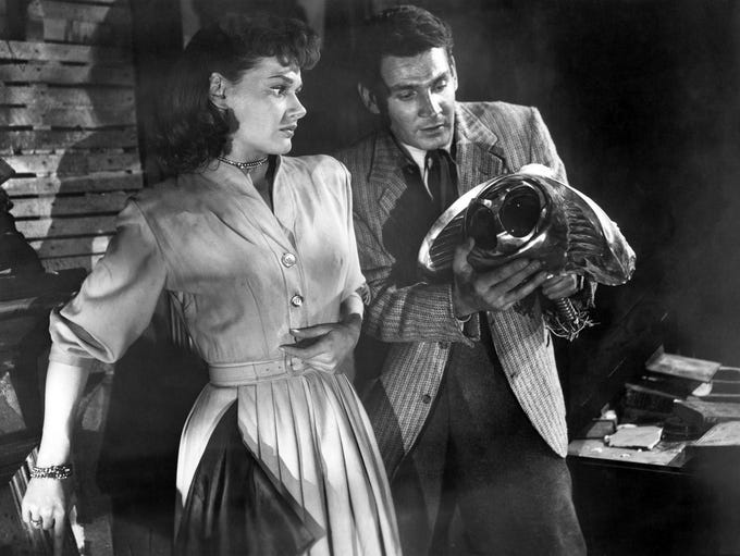 "Ann Robinson and Gene Barry in the 1953 film ""The War"