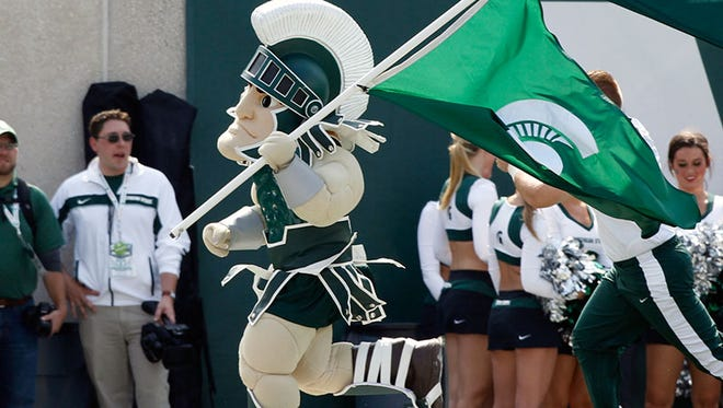 Sparty runs the sidelines after one of MSU's many touchdowns Saturday in East Lansing.