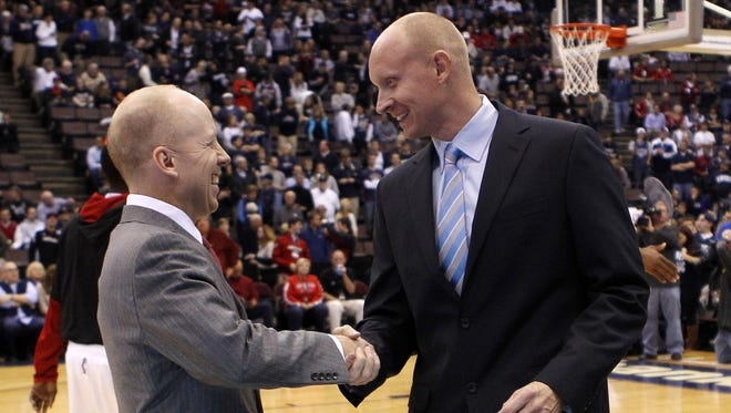 Mick Cronin (left) and Chris Mack have preseason Top 25 teams, per the USA Today Sports coaches poll. Xavier enters the season at No. 8, while UC is No. 25.