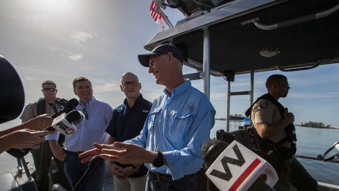 Florida Gov. Rick Scott speaks to media members during a tour of the Caloosahatchee River on the morning of Monday, July 9, 2018 in Fort Myers. The governor was touring the river to view some of the harm being caused by algal blooms from Lake Okeechobee water releases directed by the Army Corps of Engineers.