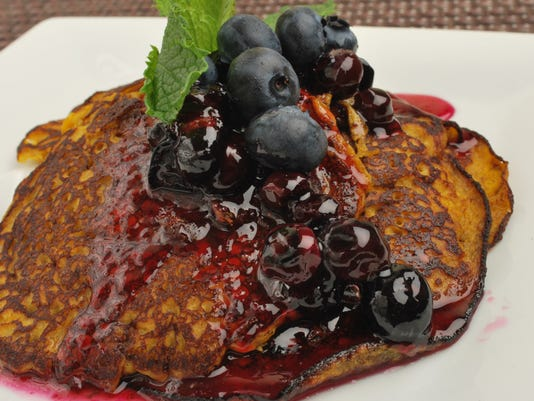 Pumpkin Pancakes with Blue Berry Syrup Plate