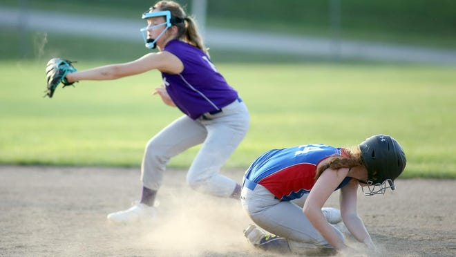 Show-Me State Home Inspections player Brooklyn Brown beats the throw to second while A-Bow-K shortstop Mylie Edwards anticipates the throw by the catcher in the fifth inning Thursday night in Babe Ruth 12U softball at Rolling Hills park. A-Bow-K picked up the sweep against Show-Me State Home Inspections, winning 10-9 and 20-12.