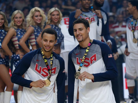 "FILE - In this Sept. 14, 2014, file photo, United States' Stephen Curry, left, and Klay Thompson celebrate after wining the final World Basketball match against Serbia at the Palacio de los Deportes stadium in Madrid, Spain. Curry has withdrawn from consideration from the Olympics, leaving the U.S. basketball team without the NBA's MVP. Curry says Monday, June 6, 2016, in a statement that he has decided to pull out for ""several factors — including recent ankle and knee injuries."" (AP Photo/Daniel Ochoa de Olza, File)"