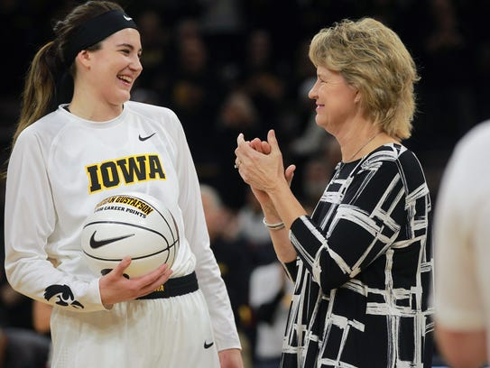 Iowa head coach Lisa Bluder congratulates Megan Gustafson