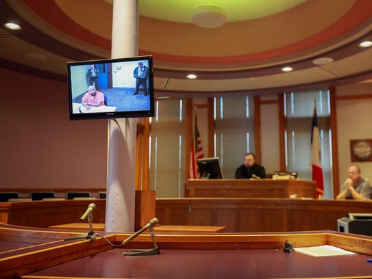 Curtis Jones is pictured through video conference at