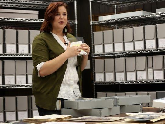 Elizabeth Riordan displays a small portion of Tom Brokaw's