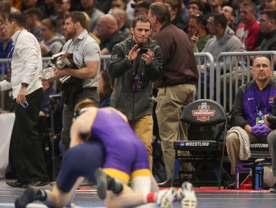 UNI head coach Doug Schwab watches Jacob Schwarm wrestle