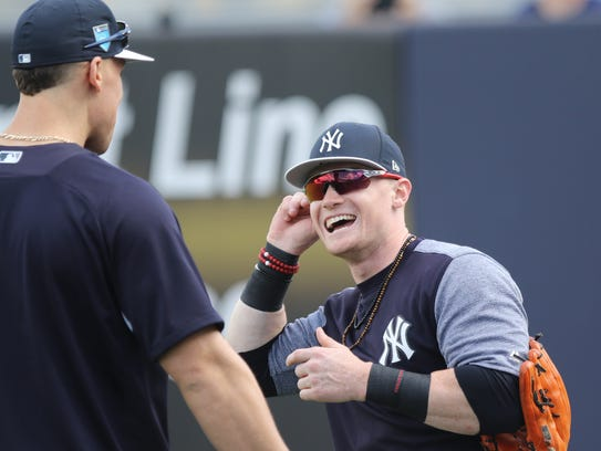 Aaron Judge and Clint Frazier have a laugh before practice.