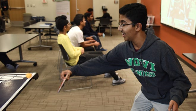 Novi High School student Dwaipayan Saha gets in a game of table tennis Jan. 12 at the Novi Public Library's Teen Space. The Teen Space, which is free and available for Novi students 2-5 p.m. each weekday, is stocked with board and video games, chess and checkers sets, table tennis and lots of areas to study and chat. The Teen Space occasionally has crafts and snacks for its visitors and is staffed by Novi Public Library personnel.
