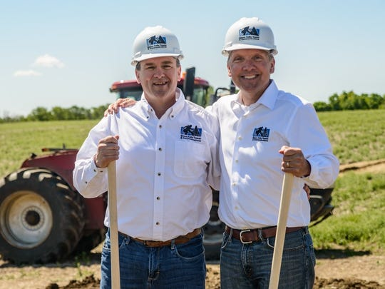 Bart Roberts and Craig Snyder stand on the site where