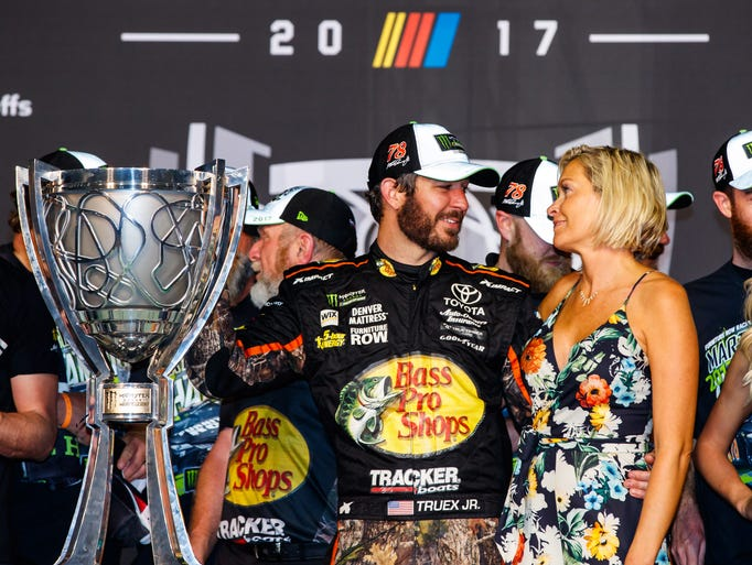 Martin Truex Jr. and Sherry Pollex celebrate with the