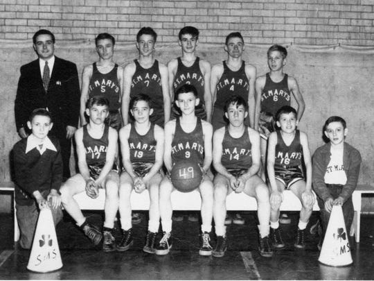 The St. Mary's grade school basketball team is pictured in September 1948. Seventh- and eighth-grade players are shown. In the front row, from left, are cheerleader Bob Kittsmiller, Jim Spires, Jack Bininger, Steven Joos, Mark Hedges, Bob Corrigan and cheerleader David Shonk; back row, coach Francis Boch, Jim Darfus, David Rempe, Joe Staten, Tom Joos and Pat Messerly.