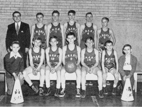 St. Mary's grade school basketball team, 1948. Seventh- and eighth-grade players in the front row from left: Bob Kittsmiller, Jim Spires, Jack Bininger, Steven Joos, Mark Hedges, Bob Corrigan and David Shonk. Back row: coach Francis Boch, Jim Darfus, David Rempe, Joe Saten, Tom Joos, and Pat Messerly.