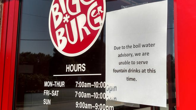 A sign on the door to Bigg Burger, 19055 Farmington Road in Livonia, states the restaurant cannot serve drinks with the boil water advisory in place. Testing continues Monday in Livonia and part of Farmington Hills to determine if any contamination took place after a power outage affected a pumping station that serves the two cities.