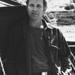"""In this photo provided by CBS, Wayne Rogers poses for a photo in his character of Trapper John McIntyre from the television series """"M*A*S*H,"""" in an undated photo."""