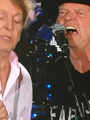 Neil Young (left) joined Paul McCartney for a Desert Trip moment Saturday in Indio