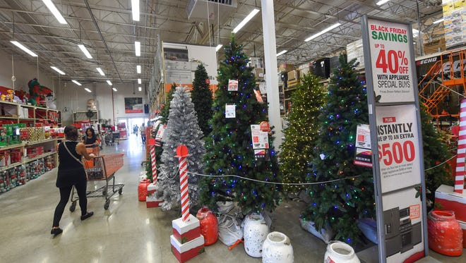 Guam shoppers stroll the holiday Christmas aisles of Home Depot in Tamuning on Nov. 20, 2017.