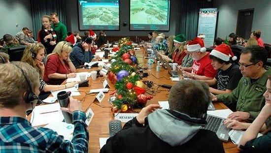 Volunteers man the NORAD Santa tracking station to answer phone calls, emails and other requests about the location of Santa on Christmas Eve.