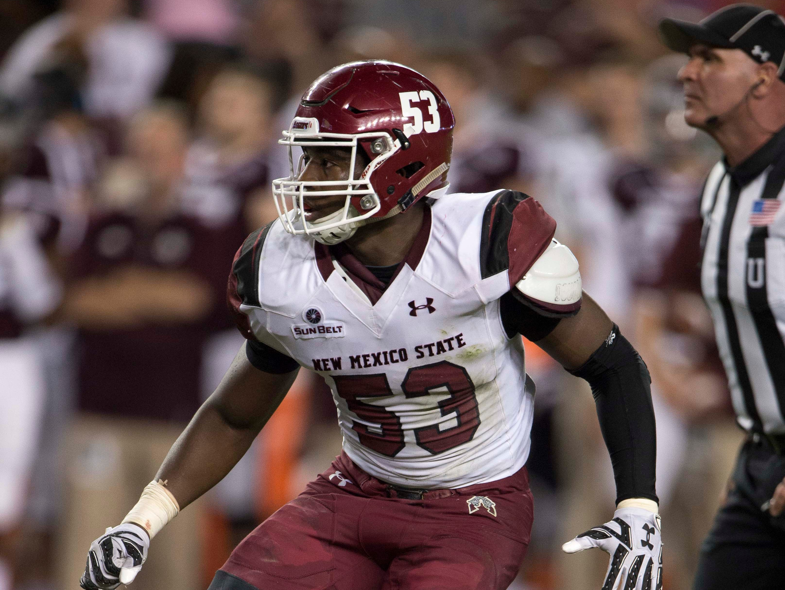 Former New Mexico State and Palm Springs High School linebacker Rodney Butler readies himself during a game at Texas A&M on Oct. 29. Butler led the NCAA in tackles this season and is preparing for the NFL draft.