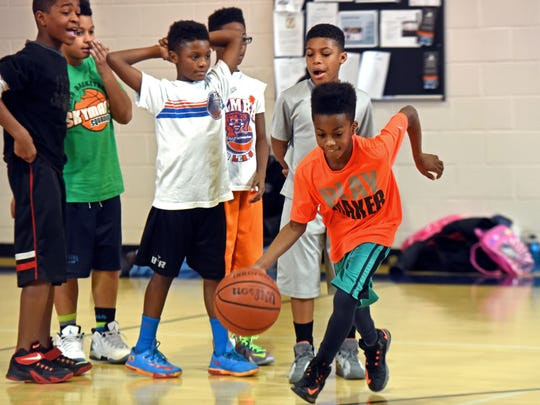 Members of the Rebirth of Camden play basketball at area gyms. Zoé Holman dribbles the ball; behind him, from left to right, are: Raashon Bounty; James Proctor, Jr.; Dwayne Smith; and Joshua Campbell, 11. Photo by April Saul