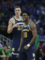 Michigan Wolverines guard Derrick Walton Jr. reacts after a three-pointer against Oregon during the second half of U-M's 69-68 loss in the NCAA tournament Thursday, March 23, 2017 at the Sprint Center in Kansas City.
