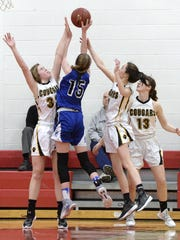 Batavia senior forward Emma Krolczyk (15) is on the verge of giving the Blue Devils three players with double-digit scoring averages.